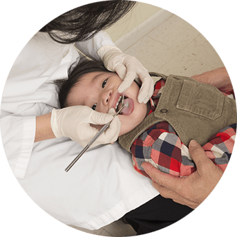 Young child receiving dental exam